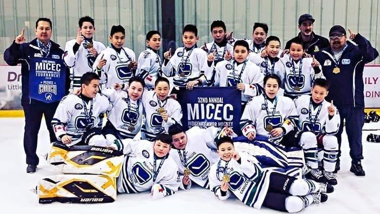 The Kivalliq Jr. Canucks peewee team bear their gold medals in triumph at the MICEC Annual Indigenous Minor Hockey Tournament in Winnipeg last month. Photo courtesy of Gleason Uppahuak